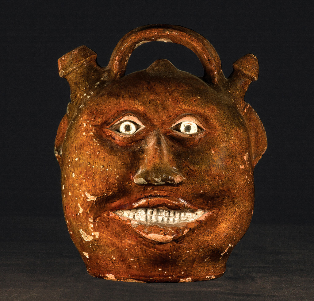 Harvest face jug attributed to Thomas Chandler (1810?–1854), Baltimore, Md., 1825–29. Earthenware with clear lead glaze and white painted details; height 10 inches.