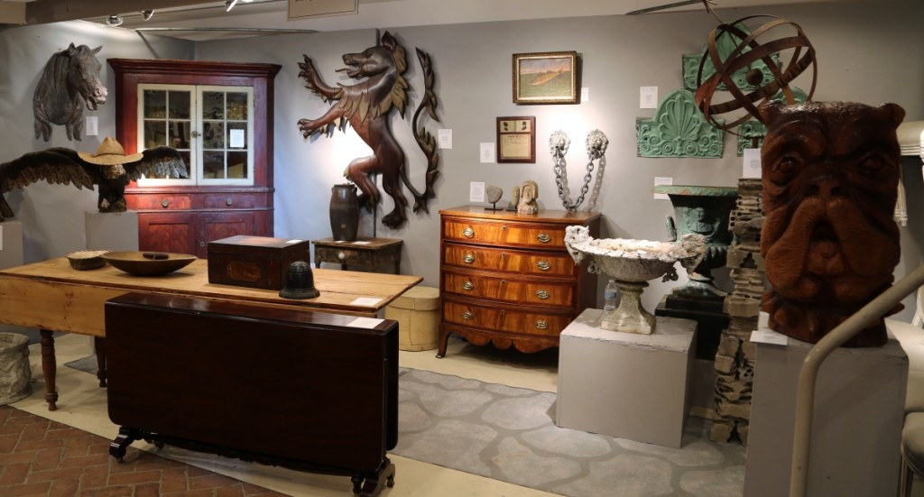 Brennan and Mouilleseaux Antiques had several standout pieces, including the painted corner cupboard, shown at the left here, and the oversized carved bulldog's head, circa 1950, shown far right. Briarcliff Manor, N.Y.