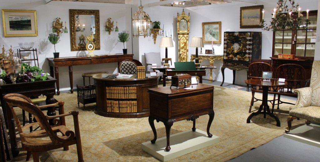 G. Sergeant Antiques, Woodbury, Conn., sales included the kidney desk in the center of the booth, the small pietra dura box on the top of the dressing table at the front of the booth, and a pair of gilt eagle brackets, one of which is shown on the back wall of the booth.