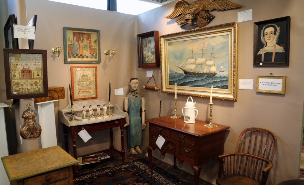 The Spanish Colonial Santos figure in the corner of Hanes & Ruskin's booth was made from tropical mahogany and had articulated arms. Old Lyme, Conn.