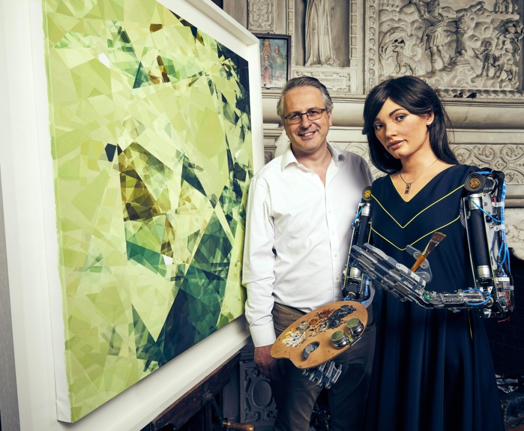 Ai-Da Robot and Aidan Meller with Painting (Photographer Nicky Johnston)