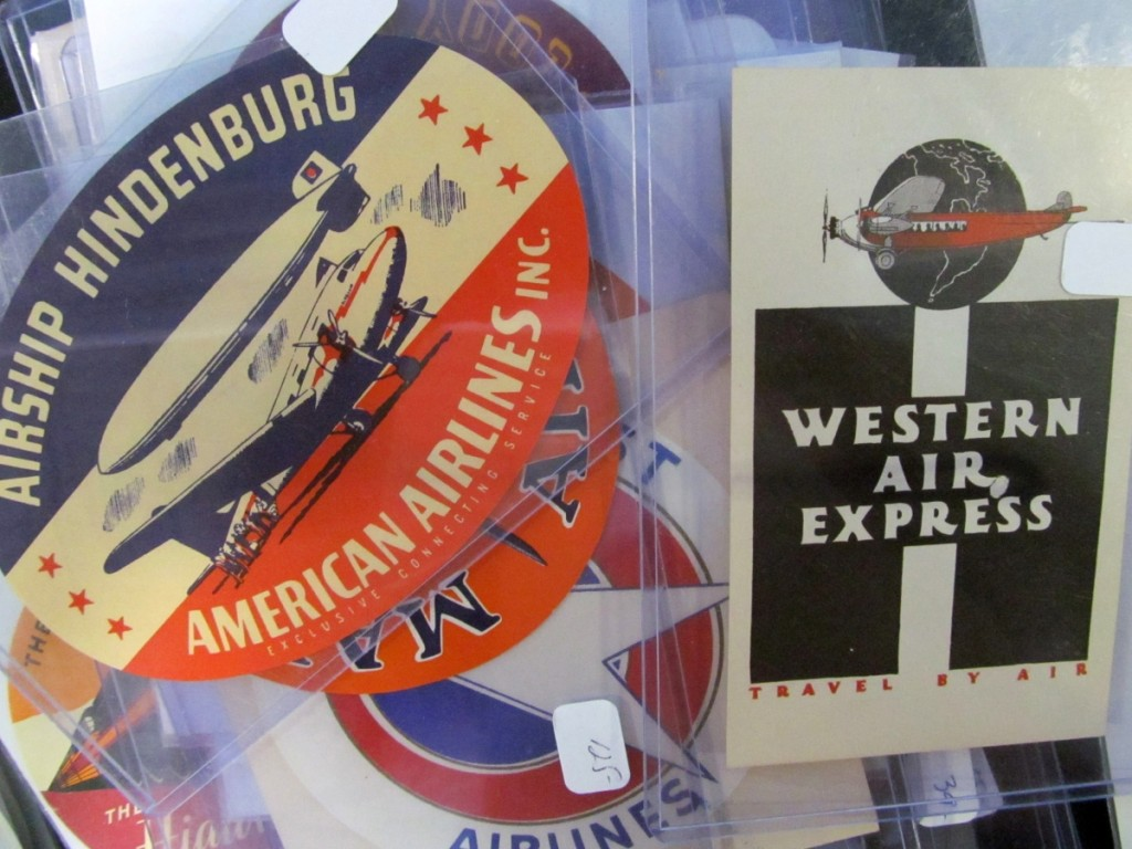 Gummed decals, similar to those issued by earlier steamship companies, became a standard airline advertising item. American Airlines offered a route that delivered passengers to the trans-Atlantic and Around the World German zeppelin terminal in New Jersey.