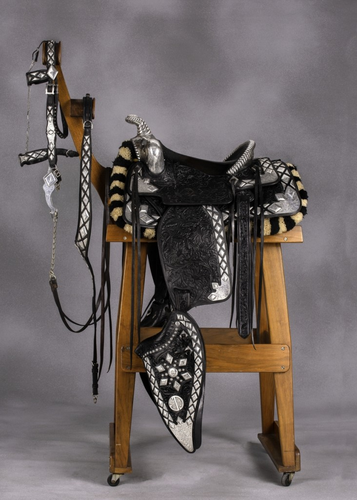 The silver-laden Dick Dickson Jr parade saddle and rig by Edward H. Bohlin was the sale's top lot, going out at $26,550.