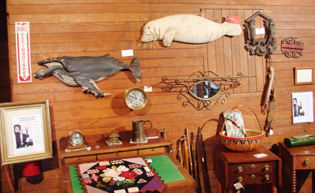 Harry Hepburn, Harrison, Maine, showcased two wonderful carvings by Wick Ahrens (1944–2016). The walrus, painted white, had a sold tag on it, and the other was of a whale, priced at $1,950.