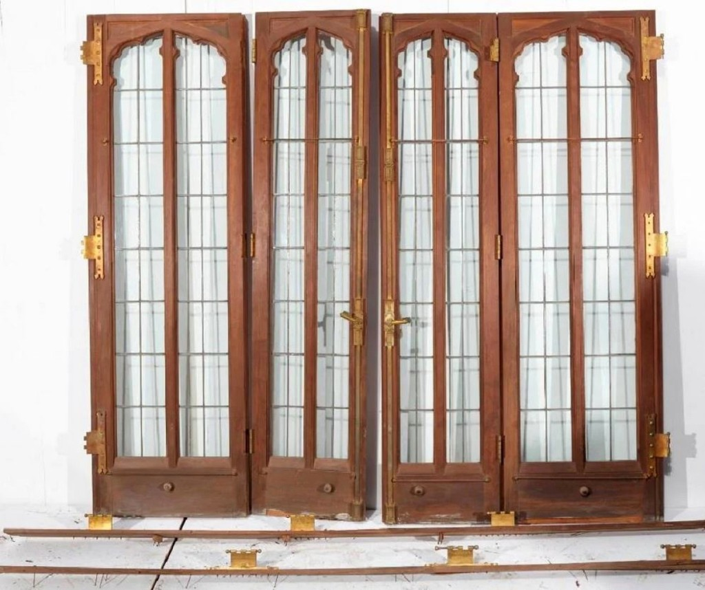 "When Frederick Brewster's ""Edgerton"" house was dismantled and auctioned in the 1960s, a gentleman bought a portion of it and stored it in his New Haven carriage house until it was brought to sale here. The top lot was this group of four interior walnut leaded glass doors, which took $4,125."