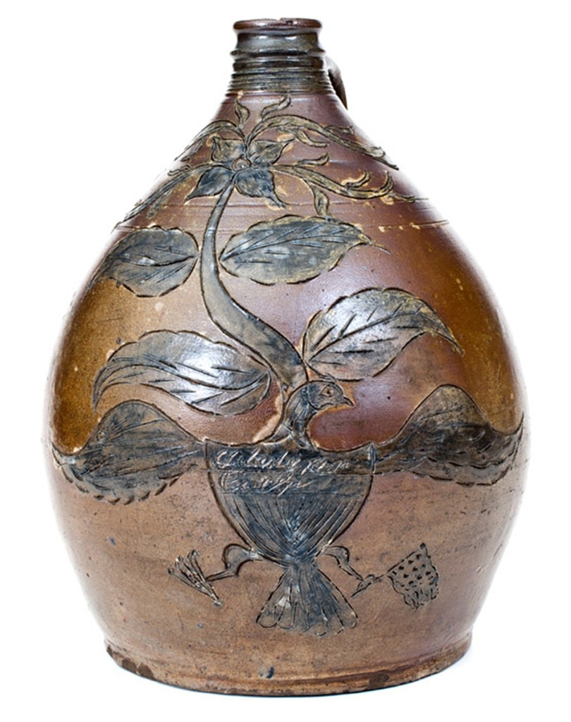"Early Nineteenth Century patriotic jug with Federal eagle, New Jersey, ""Liberty for-Ever, L. Riggs, 1819"" had been discovered in a house in the 1930s. It brought $44,250."