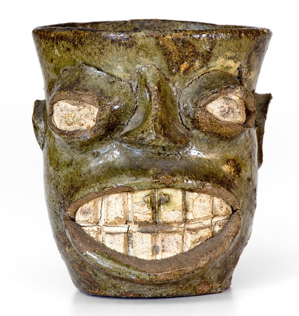 Rare and expressive Edgefield, S.C., alkaline-glazed face cup, circa 1855–70, fetched $70,800.