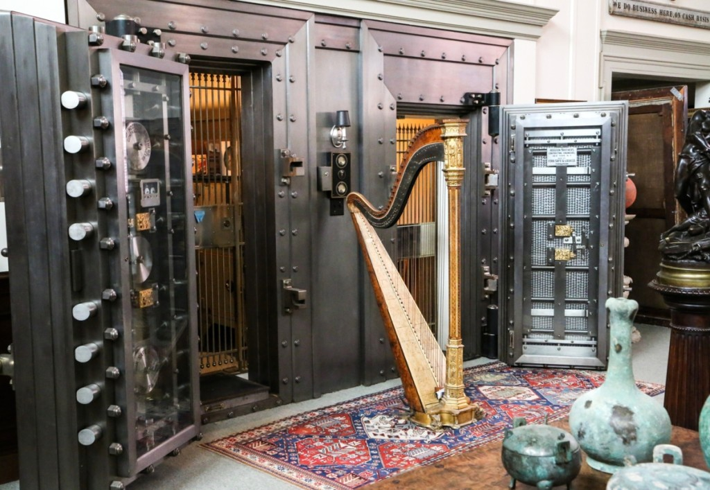 Five vaults provide secure storage for Tillou's rarest pieces. The harp is from New York. Right are Chinese Warring States vessels.
