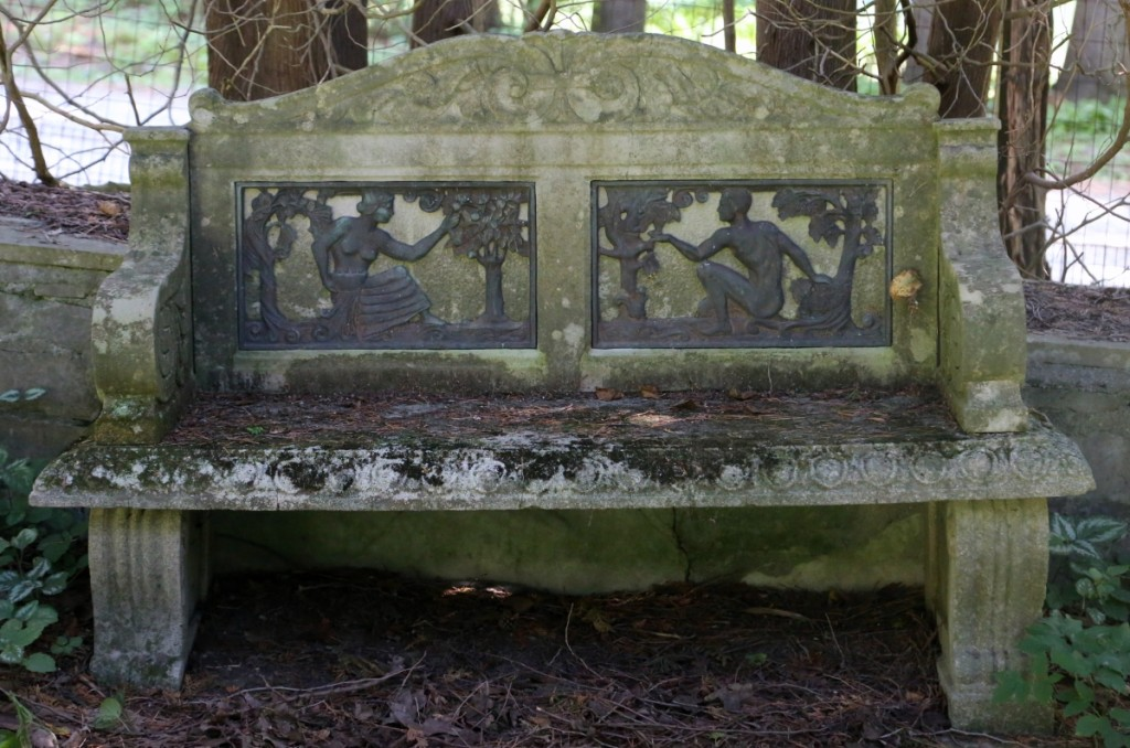 Inset with bronze plaques featuring Adam and Eve, this stone bench sold at $2,530.