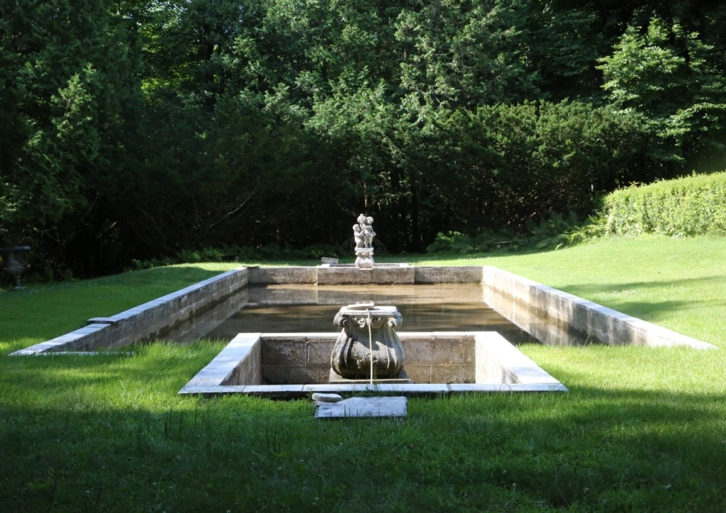 A reflecting pool sat at the bottom tier of Diana Olcott's garden.