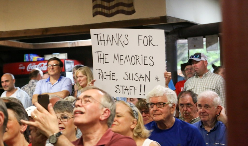 "A regular at the sale held up this ""Thanks for the memories Richie, Susan & Staff"" sign before the sale got underway."