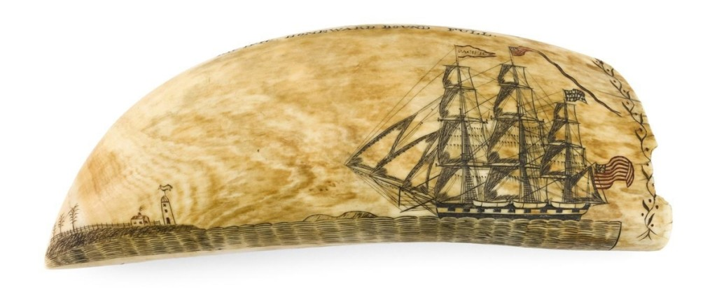 """Polychrome scrimshaw whale's tooth by Edward Burdett, circa 1830–33, length 8 inches, $384,000 ($320/380,000). Eldred's achieved a record price at auction for scrimshaw when it auctioned a similar Burdett tooth for $456,000 in 2017. Burdett was aboard the William Tell when he engraved this view of the American ship William Thomson capturing a whale. The reverse, depicted here, shows the ship Pacific homeward bound. Inscribed in a cartouche are the words """"New Bedford Ships. S.N. Potter. Master."""" Various owners."""
