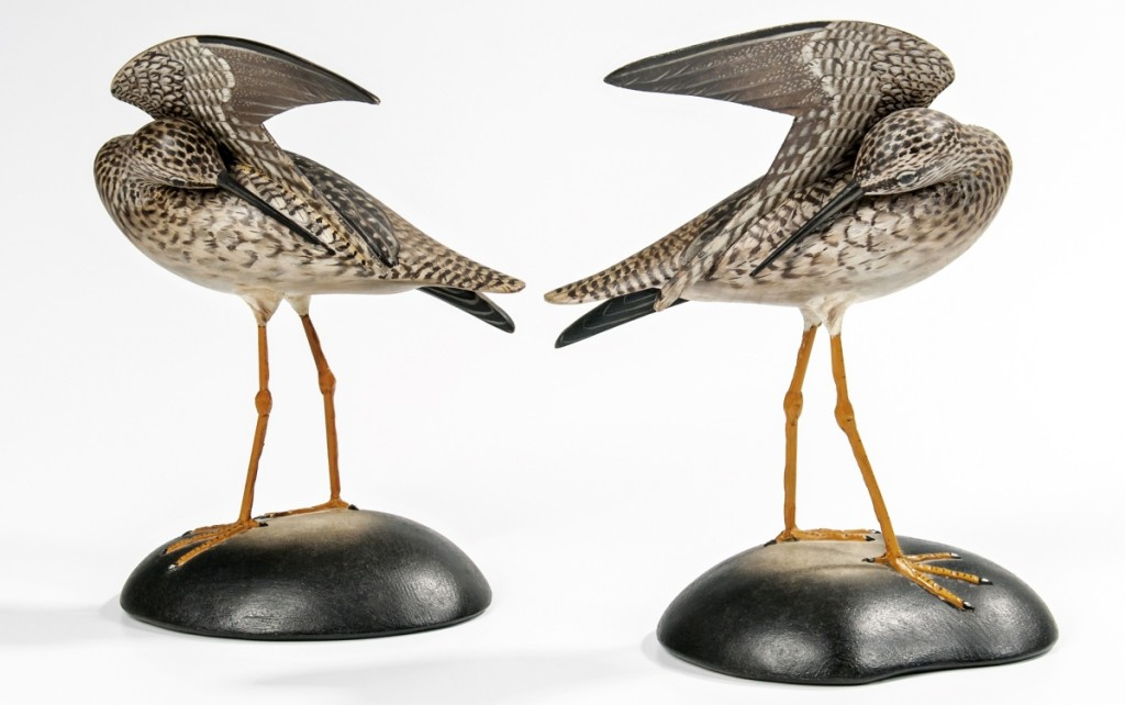 A nice pair of carved and painted preening yellowlegs, each with the rectangular Elmer Crowell mark on the base, realized $20,910. The sale included a number of decoys and decorative carvings.