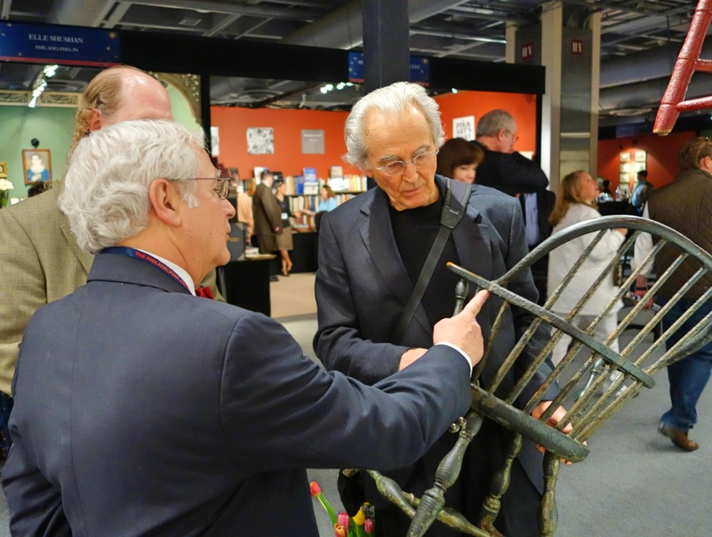 "Arthur Liverant (left), pictured here with Charles Santore at the 2014 Philadelphia Antiques Show, said, ""Charlie was a giant in the field of Windsor chairs, and his two volumes featuring photographs and illustrations really put Windsor chairs in front of everybody in the collecting world. He provided an outstanding reference for how the English Windsor transformed into the American Windsor. The American Windsor chair, for those that collect it, is very different than the English form. You sit in them — and sure, they both accomplish the mission. But the American Windsor chair is a very unusual and pure American form. And so this form was used in the homes of the colonists and also out in the country where people sat in their homes, their taverns and wherever they would meet. It was the furniture for everybody. And Charlie was that kind of person. He was easy to speak to, he was thoughtful, he was extremely humble and he had a great eye."""