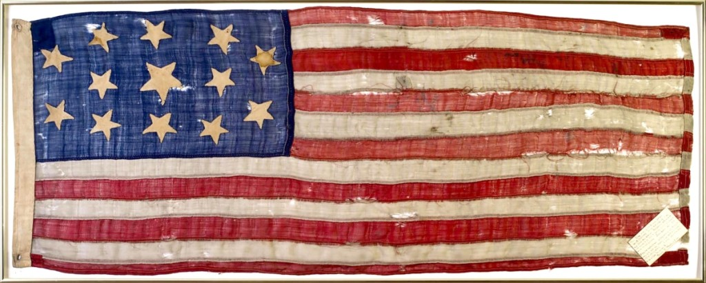 """After the sale, Ron Bourgeault said this Civil War 13-star flag was one of the surprises of the day. It sold for $27,600, far over the estimate. It was accompanied by a note that, in part, said """"this flag was given to my father Geo. W. Marshall when but a lad of 9, by a Civil War neighbor whose wife had made it for him to carry in his knapsack, which he did for the four years..."""""""