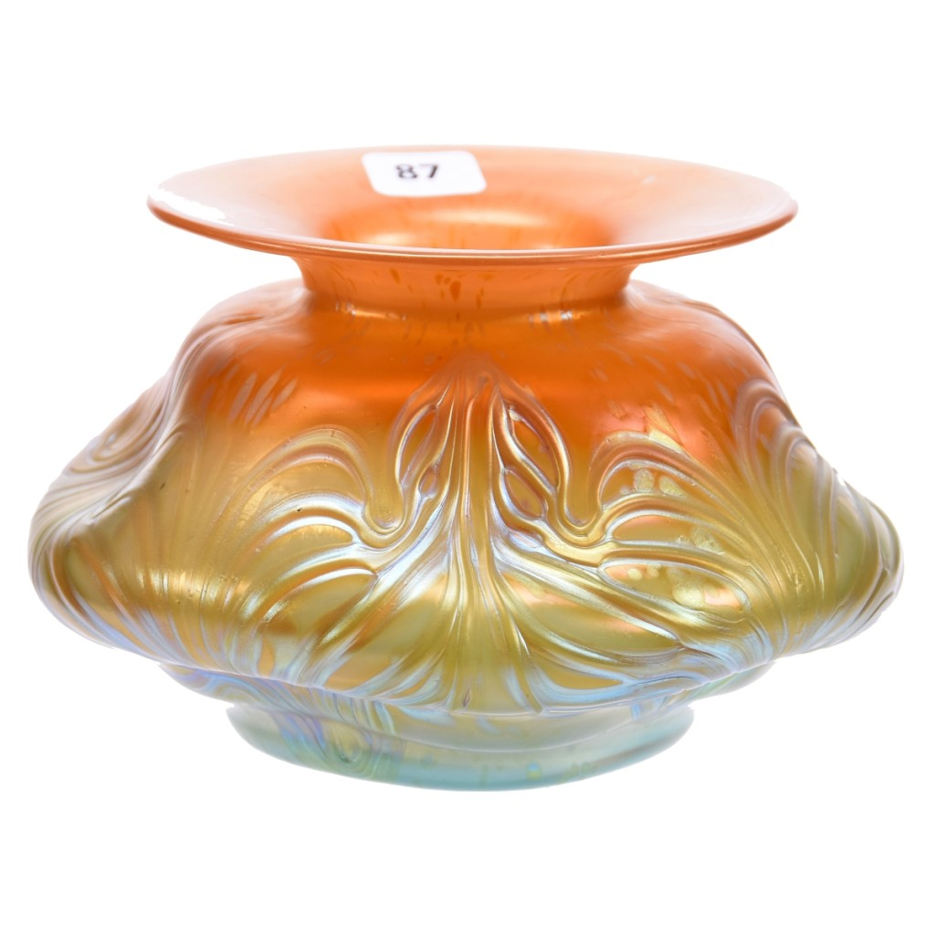 This circa 1902 Loetz Austria art glass vase in the Formosa pattern had a unique butterscotch shading to aqua color. With an estimate of $300/600, bidders competed for the 4¼-by-7-inch iridescent vase until it sold online at $3,600.