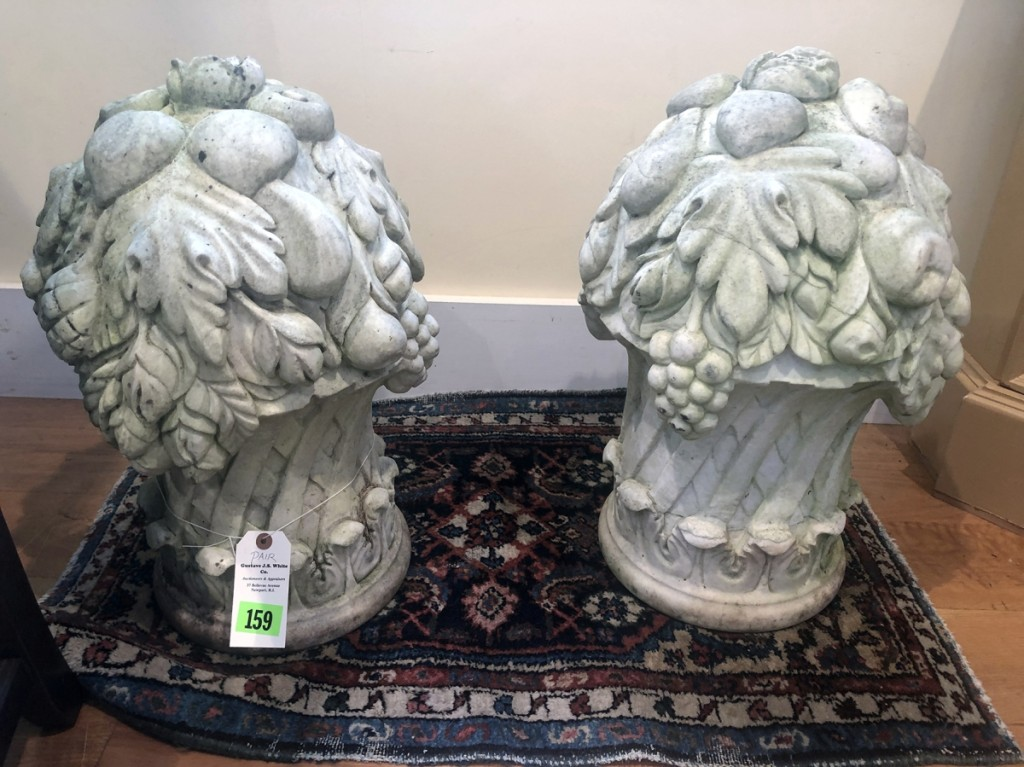 Fetching $1,800 from a customer bidding on the phone was this pair of carved marble urns that were found in a Newport, R.I., estate.