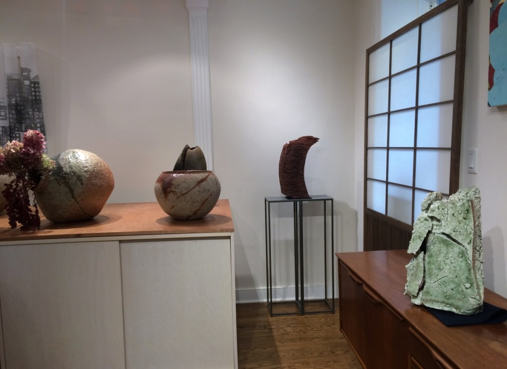 """Swing"" by Kiruma Kazuyo (center back) and Tsujimura Kai's ""Iga Flower Vase,"" (far right) both with Dai Ichi Arts, Ltd."