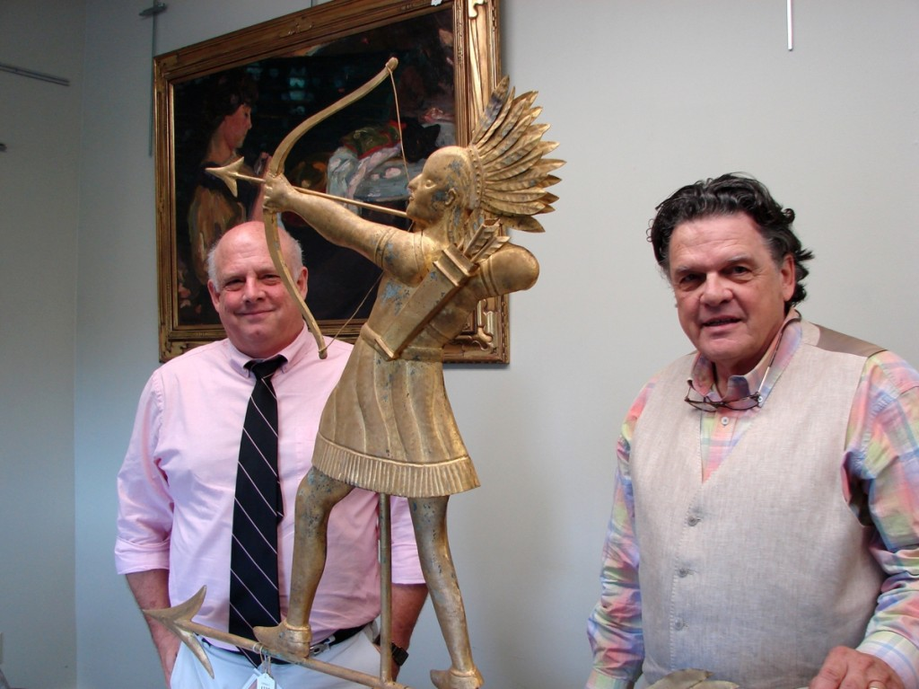Kaja Veilleux, right, and John Bottero, vice president, with the Indian chief weathervane that sold for $33,930.