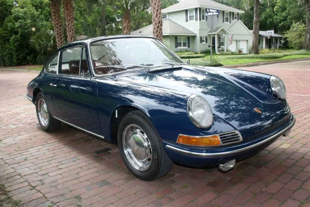 A 1965 Porsche 911 with its original special order color combination of Bali Blau exterior with original/unrestored red interior caught the eye of several bidders who pushed the final price to $176,000.