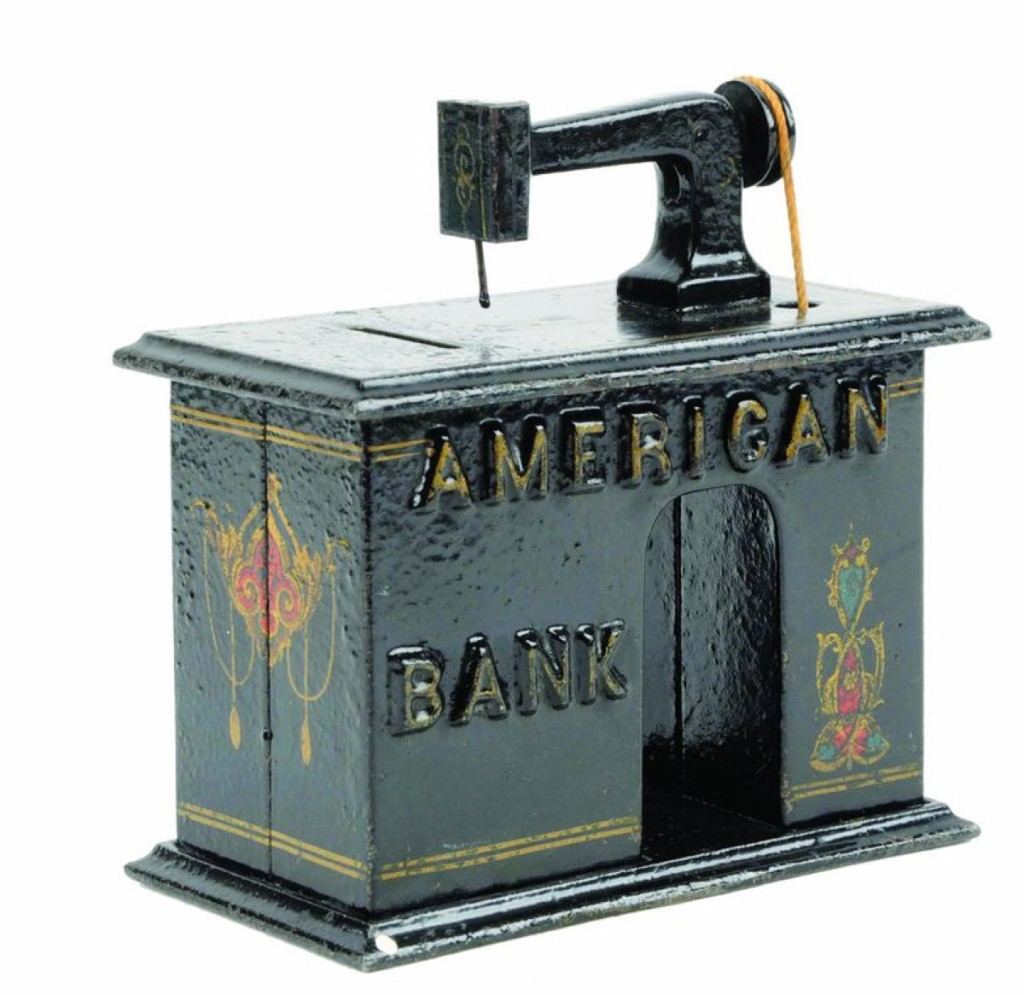 In near mint condition with embossed letters, an American Bank mechanical bank brought above estimate at $15,990.