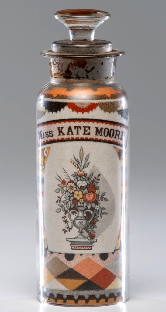 Andrew Clemens (1857-1894), large sand bottle decorated on one side with a spreadwing eagle beneath a 36-star flag and an urn of flowers on the other, realized $100,000, the fourth such bottle to bring $100,000 or more at Cowan's.