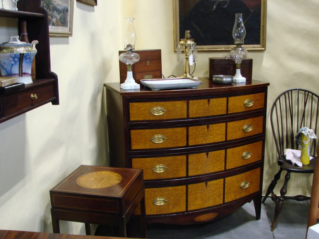 20th Maine, Pownal, Maine, brought some formal furniture, including a highboy and this four-drawer bowfront inlaid chest of drawers.