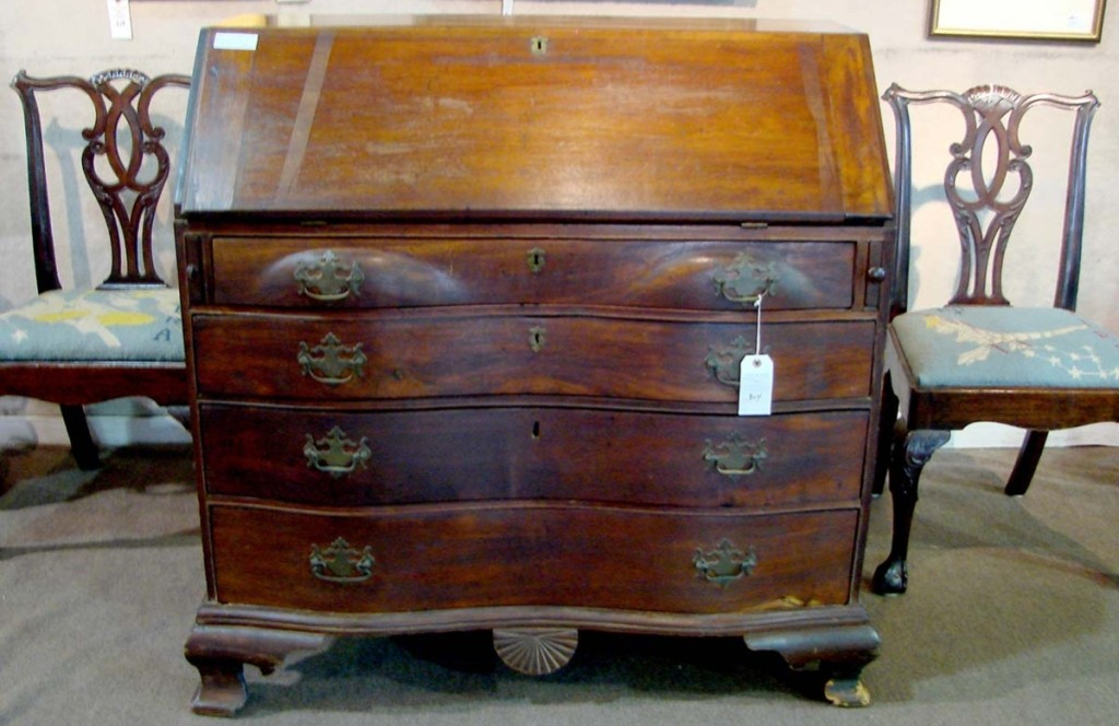With connections to the Revolutionary War, this 42-inch slant lid mahogany desk with a fan-carved drop panel and interior drawers sold for $2,300.