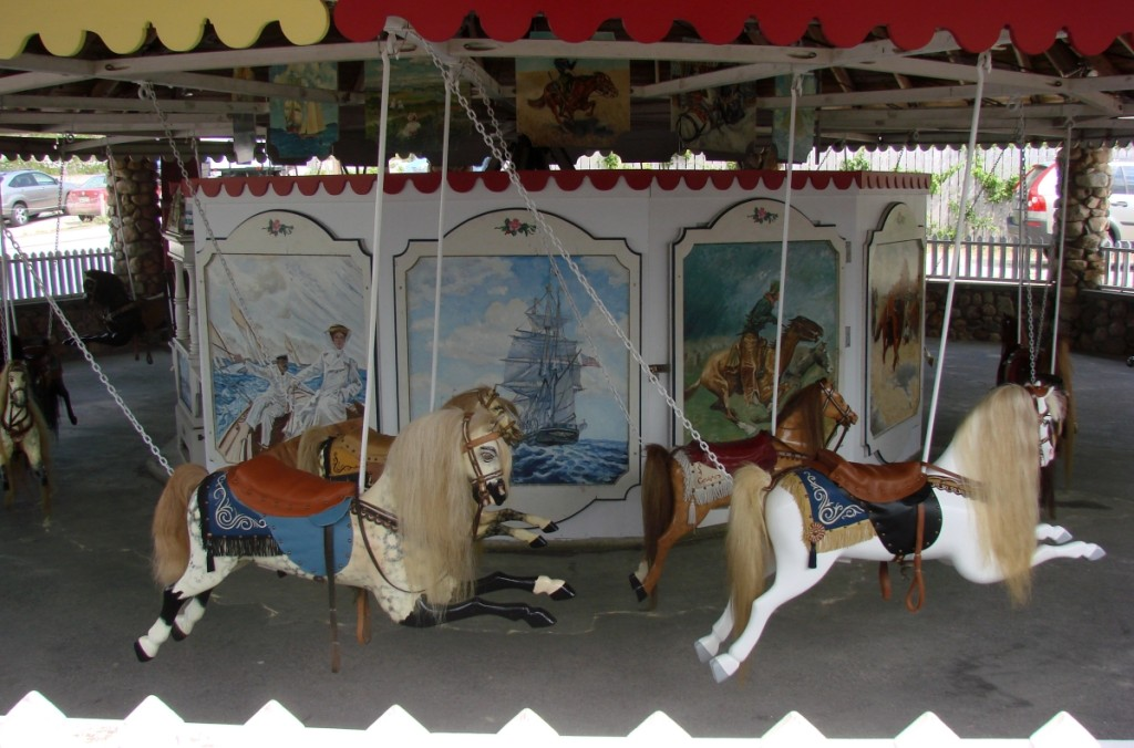 The Watch Hill Flying Horse Carousel is in a brightly painted pavilion next to the beach entrance.