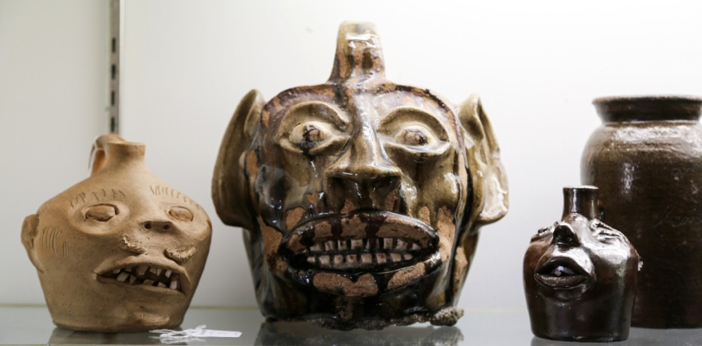 Some call them grotesque, but others call them beautiful. At left is a stoneware face jug, attributed to Guy Daugherty, Bethune, S.C., circa 1950, that took $2,242. Crocker Farm was confident in the attribution on account of the construction of the face and the eyes, which typify the potter's work. At center is the largest Edgefield face jug that Crocker Farm has ever sold, and it finished as the second highest lot in the sale at $28,320. The piece had descended in a family since 1964, when it was purchased at Vern House Antiques, Croton-On-Hudson, N.Y., for $87.50. On the right is a small stoneware face jug attributed to Brown Pottery, Arden, N.C., circa 1930, in an Albany slip glaze, that brought $2,596.