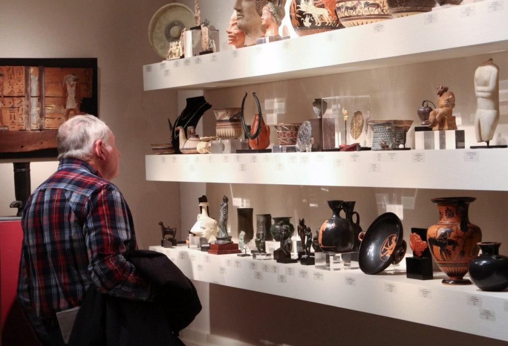 A showgoer looks through some of the antiquities at Phoenix Ancient Art.