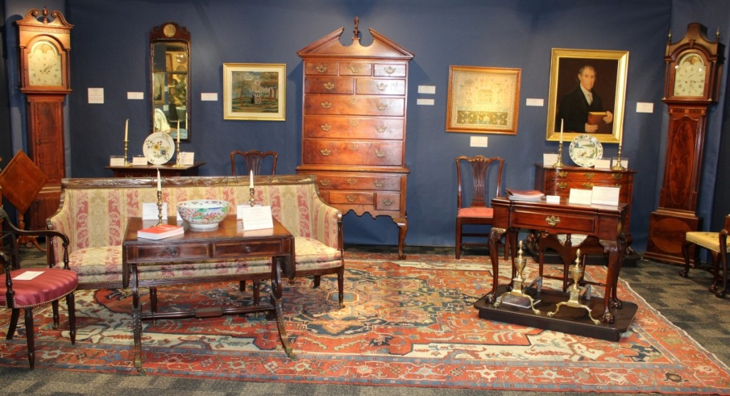 The big sale of the show for Bernard & S. Dean Levy Inc was the George C. Curtis Philadelphia Chippendale card table. It is shown on the plinth in the center right of this photograph and sold on opening night.