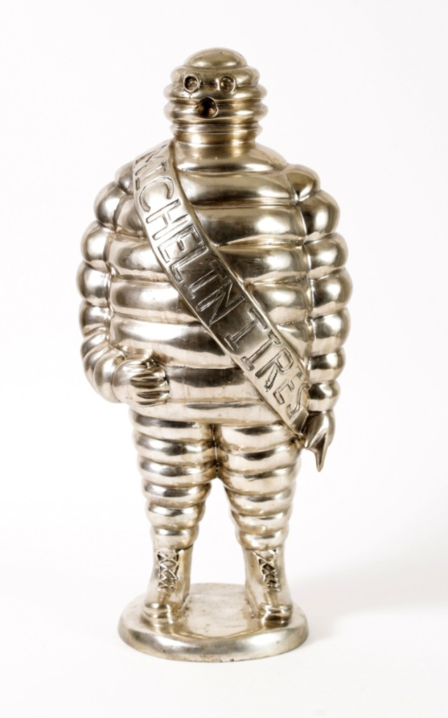 A French silvered bronze Bibendum or Michelin Man sculpture, 22 inches high and almost 17 pounds, given to Bourdain by Marco Pierre White; after multiple extended bidding sessions, it sold at $61,250.