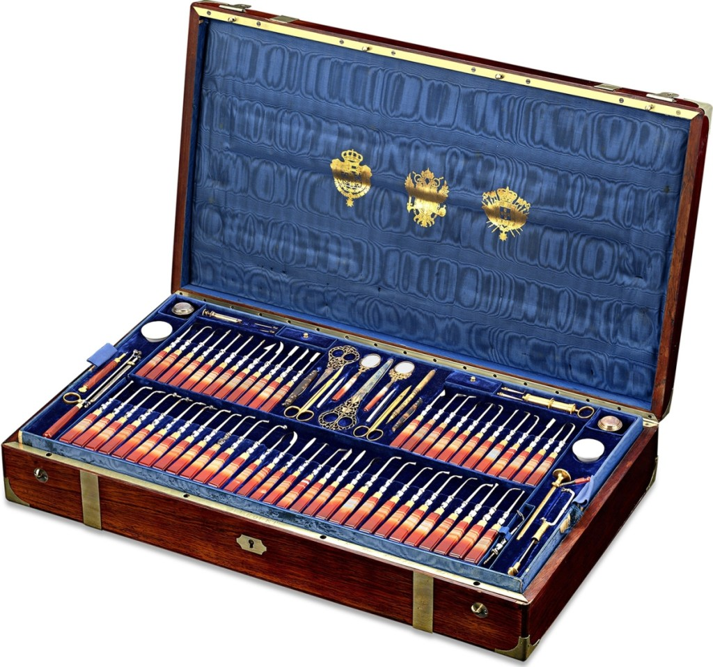 With M.S. Rau Antiques, New Orleans, La., was this Royal Spanish dental kit, commissioned by Isabella II, Queen of Spain (1833-1868) for her personal doctor and dentist, Dr Louis Ernst. It includes more than 120 instruments by such makers as Terzano, Charrière, Daran, C. Ash & Son and Bucquet. The tools were set into gilt-metal and rose agate handles and housed in a fitted blue velvet-lined mahogany case with brass fittings and bearing the royal coats of arms of Spain and Portugal, and the imperial arms of Austria.