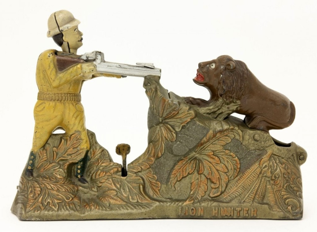 The Lion Hunter cast iron bank, with Teddy Roosevelt encountering the king of the beasts, who rears up when a coin is shot at him from Teddy's rifle. However, the coin deflects off the rocks into the bank. Made by J&E Stevens in 1911, it brought $28,800, below its low estimate. Its condition is near mint-plus and has a provenance of Larry Feld Collection.