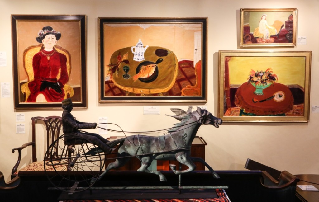 A horse and sulky weathervane attributed to Fiske sits before a wall of paintings by Russian-born artist Nicolai Vasilieff (1887-1970). Vasilieff's last year's were spent living and working in Lanesboro in Western Massachusetts. Jeffrey Tillou, Litchfield, Conn.