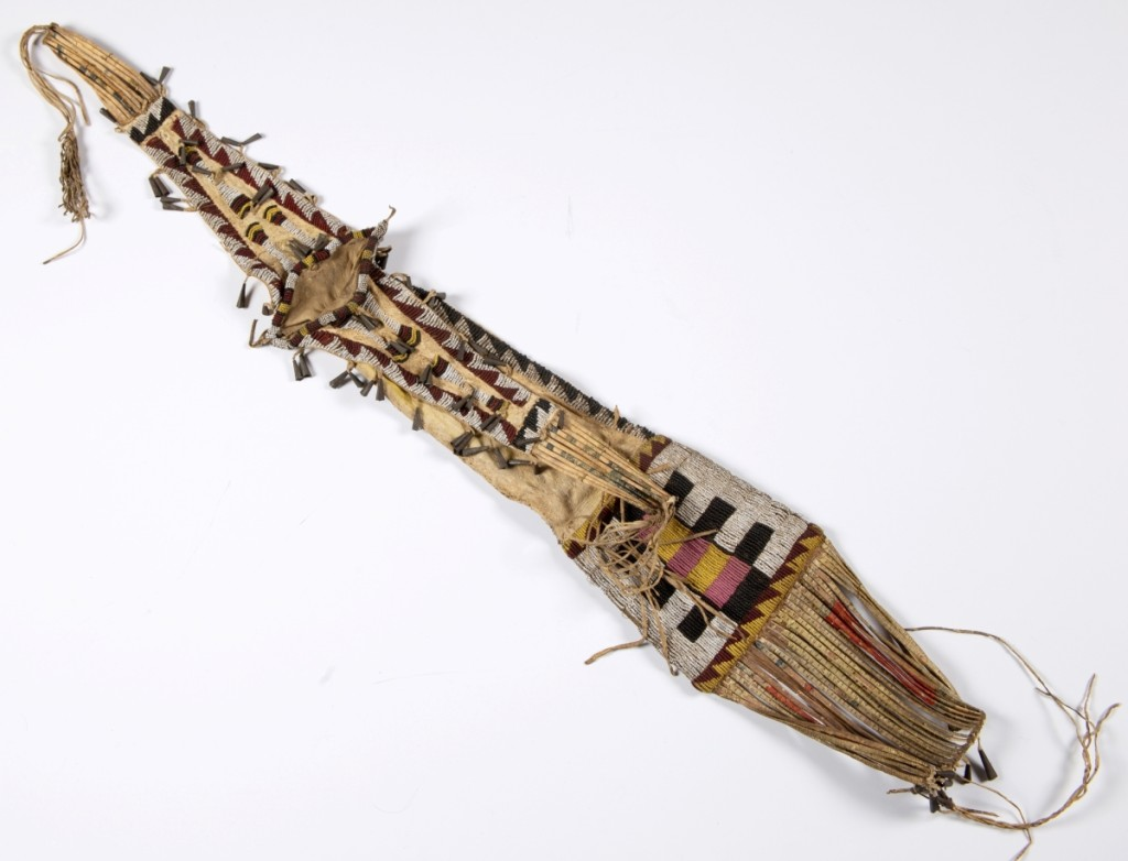 This Native American Plains Indian beaded and quilled pipe bag, circa 1870, topped out at $23,400 ($300/500).