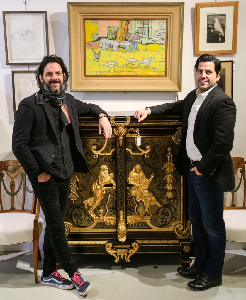 Michael, left, and Mark Millea stand around their top lot, one from a pair of Armoire A Medailles cabinets attributed to Nineteenth Century Parisian cabinetmaker Béfort Jeune. The pair, which brought $43,750, sold to a dealer.