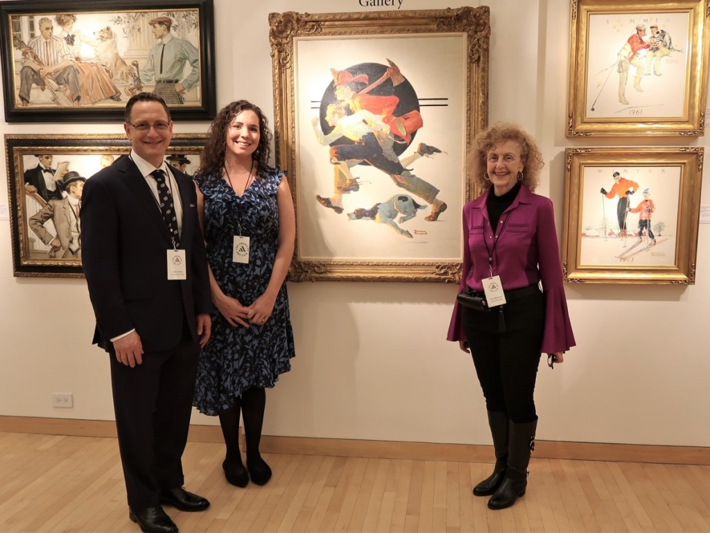 """Andrew Goffman, Sara Bliss Cohen and Judy Goffman Cutler with the 1931 oil on canvas """"Volunteer Fireman"""" by Norman Rockwell, reproduced in the Saturday Evening Post the same year."""