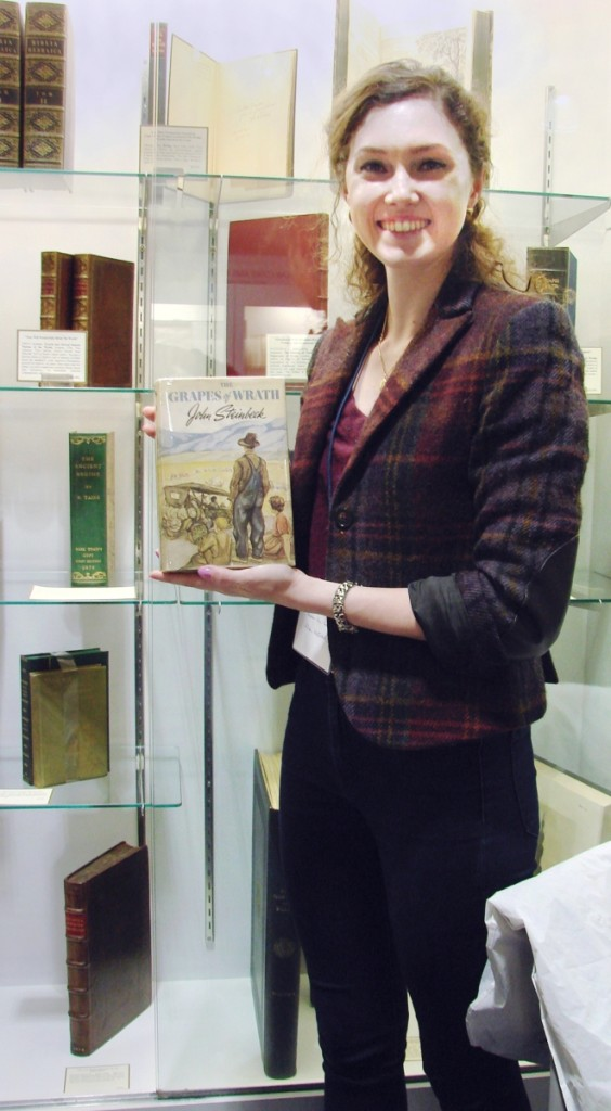 """Twenty-eight-year-old Allison MacIntosh, with a degree in the classics, has worked for Bauman Rare Books, New York, for about three years. """"I'm learning something new every day,"""" she said, holding up a first edition of John Steinbeck's Grapes of Wrath priced at $29,500.               —Boston   International Antiquarian Book Fair"""