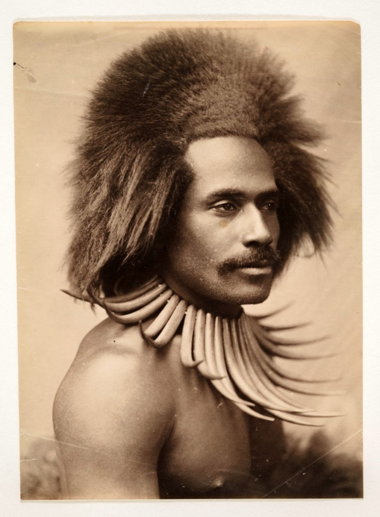 """Fijian Warrior (with Whale Tooth Necklace)"" probably by John William (J.W.) Waters, 1880s. Albumen print, Los Angeles County Museum of Art. Partial gift of Mark and Carolyn Blackburn and purchased with funds from LACMA's 50th Anniversary Gala and Fiji Water. Photo ©Museum Associates/LACMA."