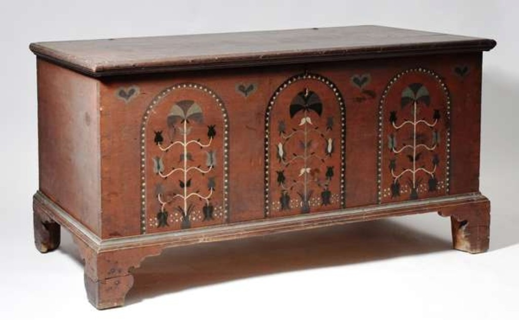 A Pennsylvania paint-decorated dower chest in red with black, green and white decoration earned $4,600.