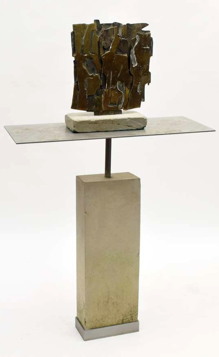 "One of the highest priced items in the sale was this Brutalist bronze by Pietro Consagra. It was an abstract piece mounted on a cement and steel base, signed ""Consagra '61"" and it sold for $19,500."