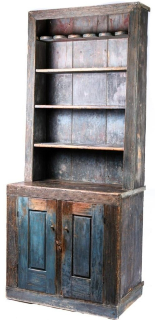 One of the pleasant surprises of the furniture portion of the sale was this cant back cupboard in old blue. Thought to have been made in Hackensack, N.J., it finished well over the estimate at $8,260.
