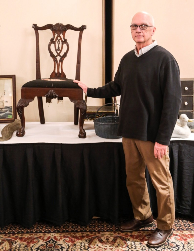 David Straight stands with his top lot, a 1760-70 Philadelphia side chair that sold above estimate at $4,150. It sold to a Nashville, Tenn., bidder.