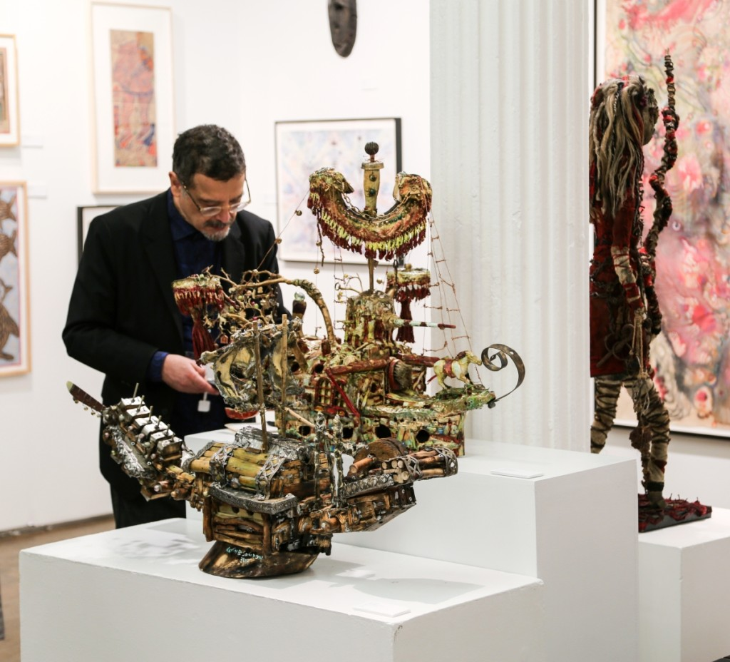 "Contemporary works by artist Kevin Sampson were represented at Cavin-Morris Gallery, New York City. Seen here are two mixed media and found object works, ""Shogun"" and ""USS Enterprise."""