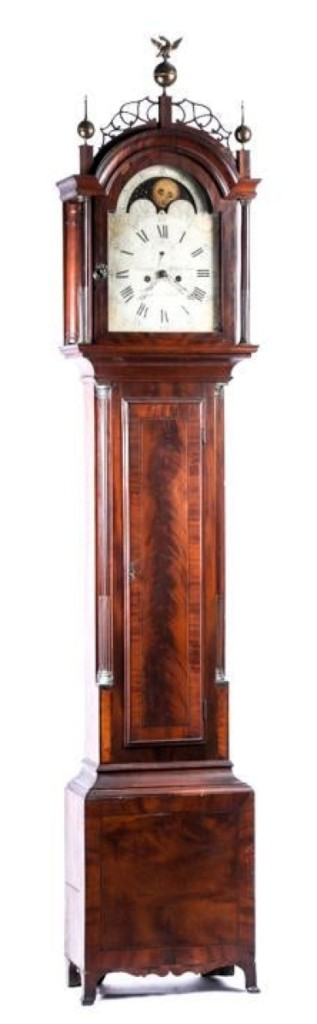 """Bringing the highest price of the two-day sale, $38,350, was this Simon Willard tall case clock. The dial was painted """"Warranted for Capt. John Brown,"""" along with Willard's name."""