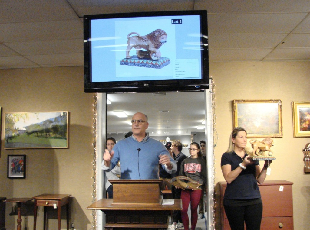 All items at Smith's auctions are brought to the front of the gallery so that buyers can see what they're bidding on. The colorful Staffordshire lion got the day off to a good start, bringing $1,035.