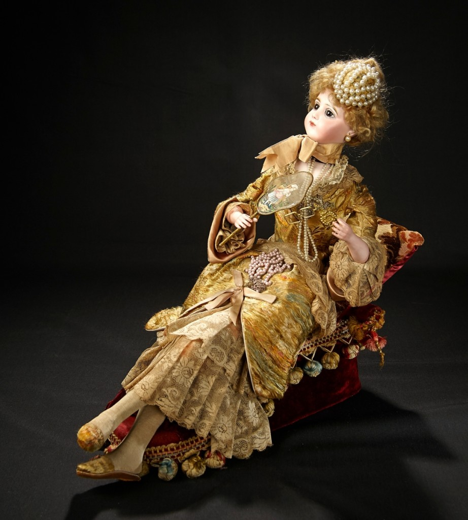 "This lovely lady, a splendid musical automaton, ""Elegant Lady Reclining on Recamier"" by Leopold Lambert, circa 1885, sold at $48,300 for a rare, intricate and artistic model."