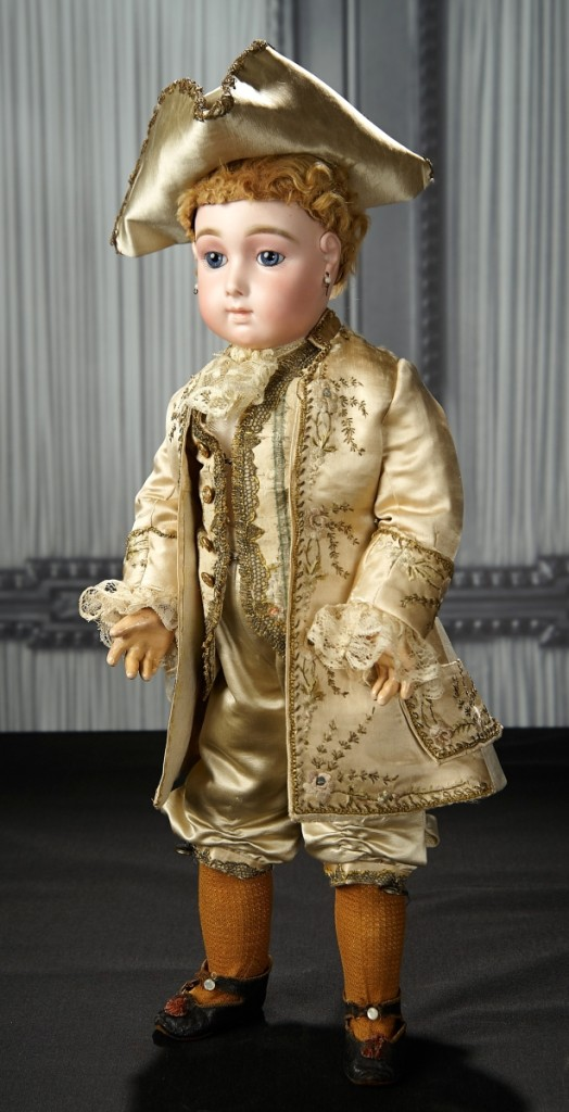 French bisque blue-eyed bebe triste by Emile Jumeau in rare ivory satin Marquis costume ($11/15,000) sold at $39,100.
